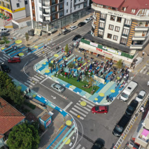 Parking lot with trash bins in Istanbul turned into a low-cost public square and play space